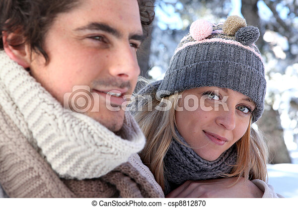 Young man and young woman wearing wool cap - csp8812870