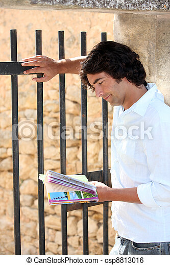 Sightseeing consulting a brochure - csp8813016