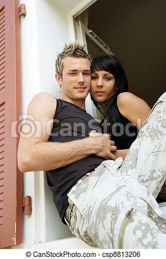 Couple sat on a window sill - csp8813206