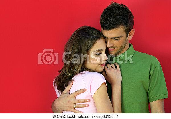 Couple enjoying a cuddle - csp8813847