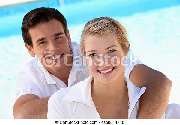 Grinning young couple - csp8814718
