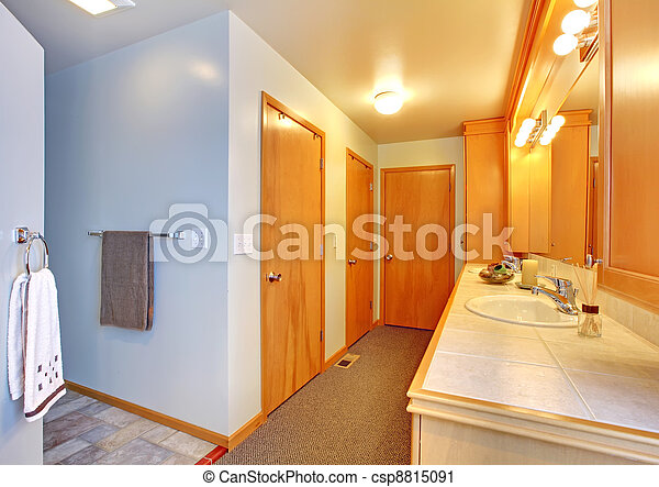 Bathroom house interior with many doors to closets. - csp8815091