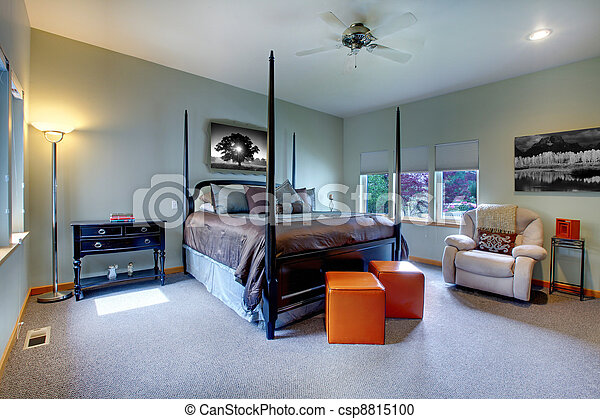 Large bright modern bedroom interior design with post bed. - csp8815100