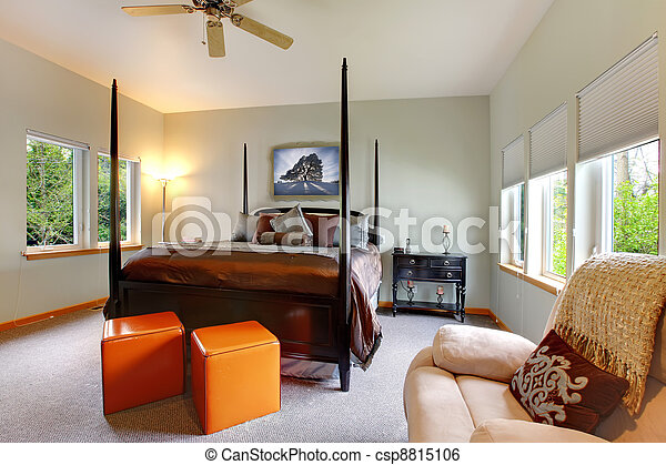 Large bright modern bedroom interior design with post bed. - csp8815106