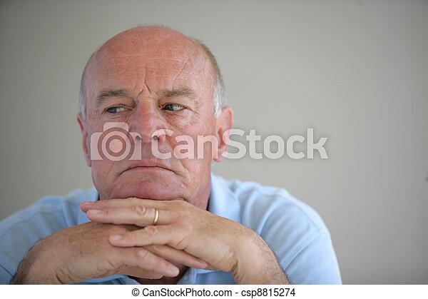 A worried elderly man