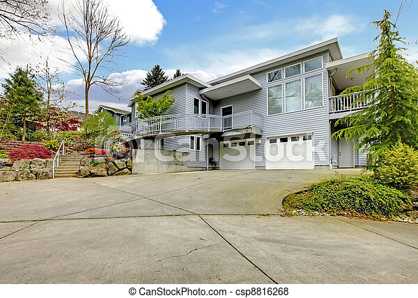 Large grey modern home exterior  with large driveway. - csp8816268