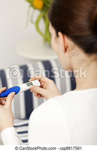 Bruentte woman with pregnancy test  - csp8817561