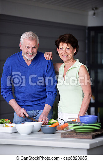Elderly couple preparing a meal - csp8820985