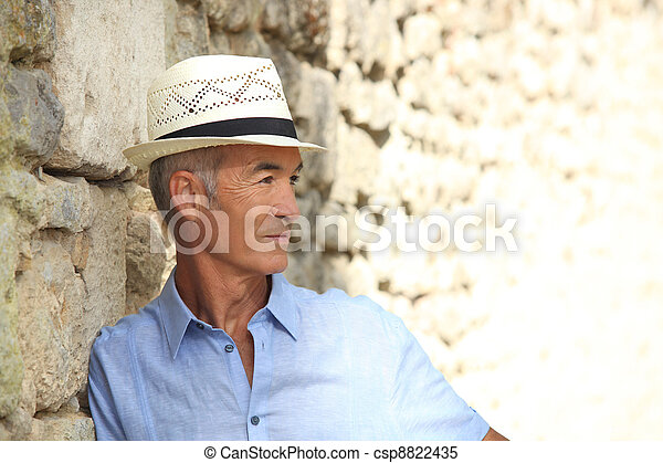 profile view of pensioner on holiday - csp8822435