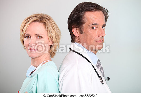 Male doctor and female nurse - csp8822549