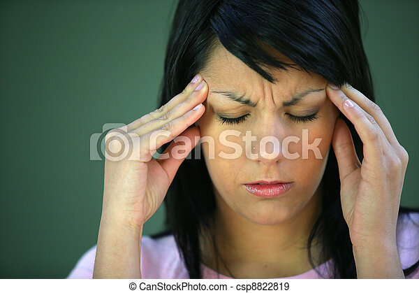 Brunette suffering from tension headache - csp8822819