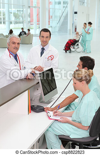 Staff at hospital reception - csp8822823