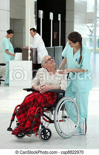Nurse with an elderly lady in a wheelchair - csp8822970
