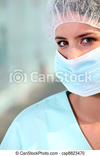 nurse wearing surgical mask - csp8823470
