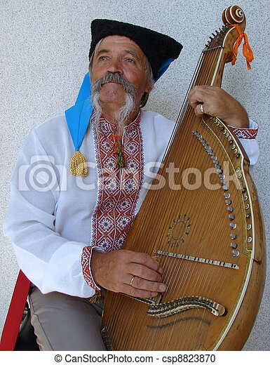 Senior ukrainian traveling musician named kobzar with bandura - csp8823870