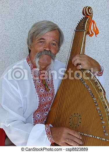 Senior ukrainian traveling musician named kobzar with bandura - csp8823889