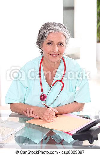 Confident female practitioner - csp8823897