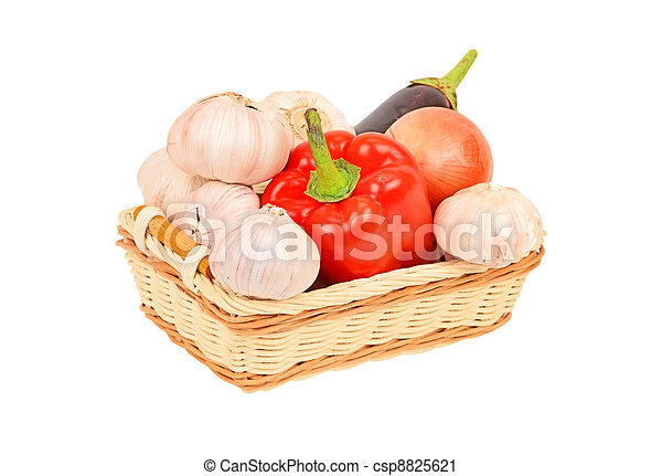Vegetables in a wattled basket, isolated on white background - csp8825621