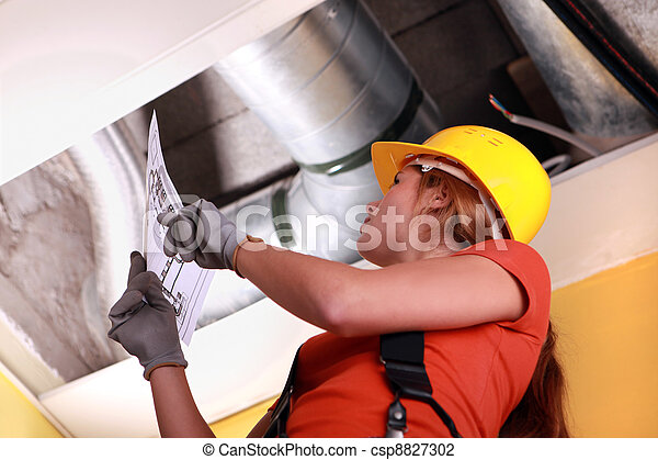 Woman checking ventilation system - csp8827302