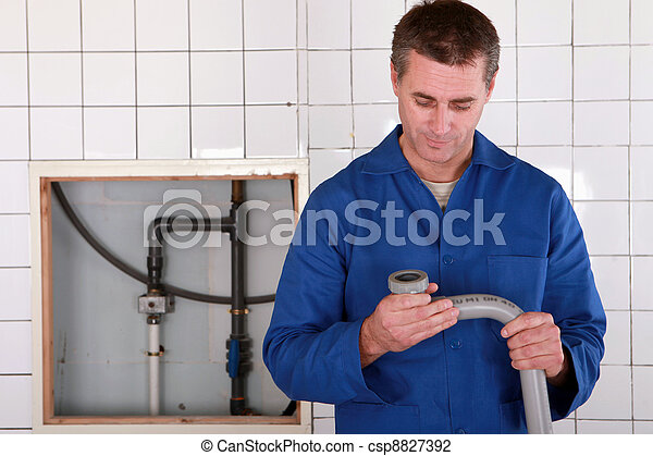 Skilled worker replacing defective pipe - csp8827392
