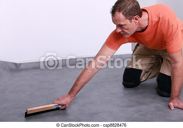 stock bild von handwerker nivellieren der boden csp8828476 suchen sie stock fotografie. Black Bedroom Furniture Sets. Home Design Ideas