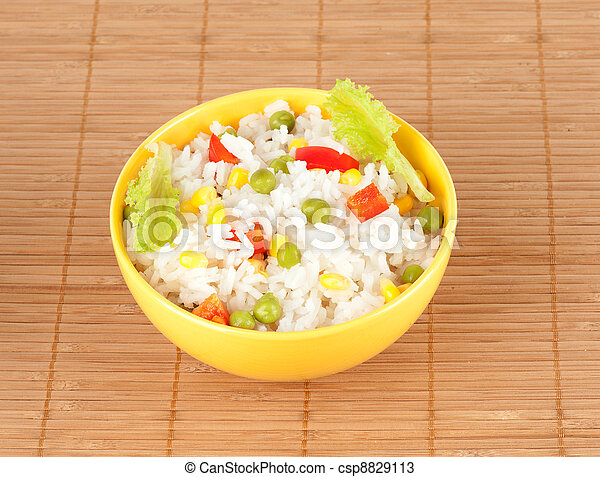 cooked rice in bowl with vegetables - csp8829113