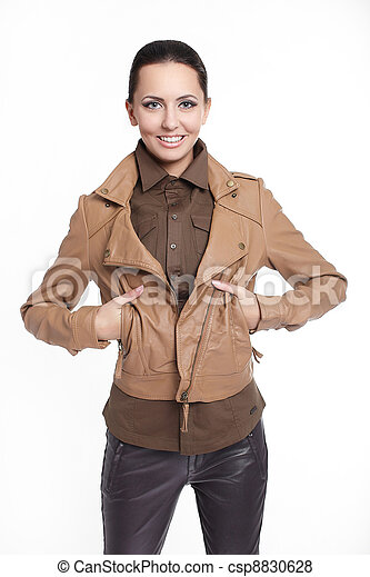 Young beautiful sexy smiling stylish woman in brown jacket isolated on white  - csp8830628