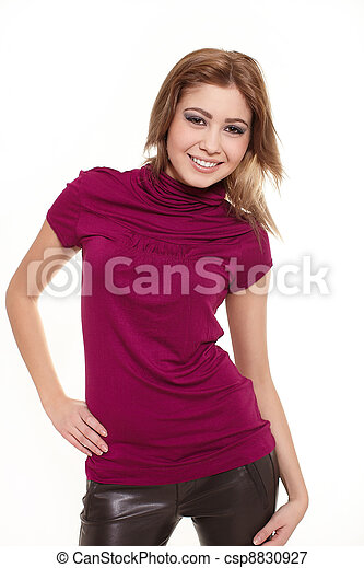 Young sexy smiling stylish beautiful smiling woman in pink jersey isolated on white - csp8830927