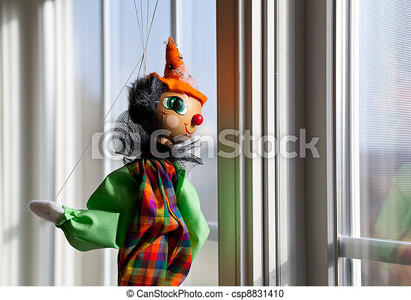 String puppet gazing outside window in sun - csp8831410