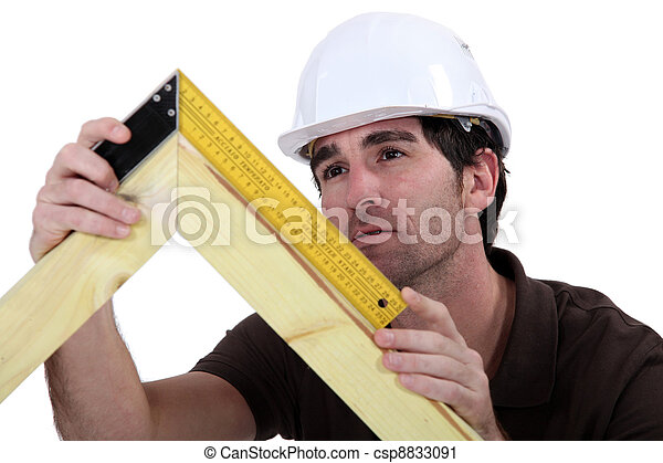 Carpenter making a frame - csp8833091