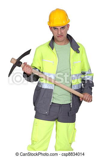 A man holding a pickaxe with a serial killer face. - csp8834014