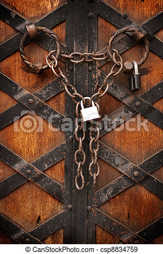 Iron padlock and chain on old door - csp8834759