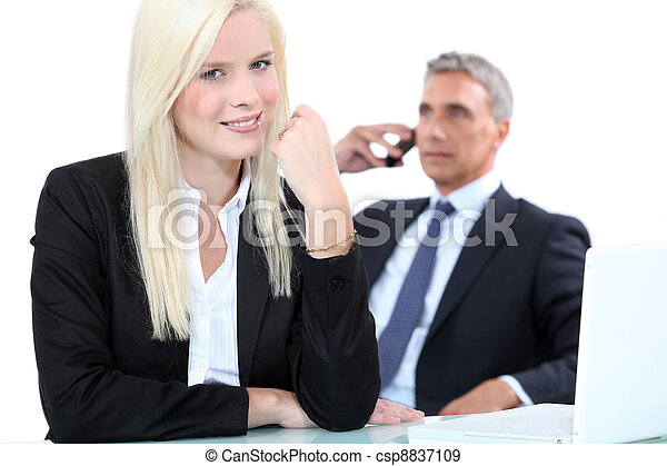 Stock Photo - a blonde woman and a mature man well dressed, ...