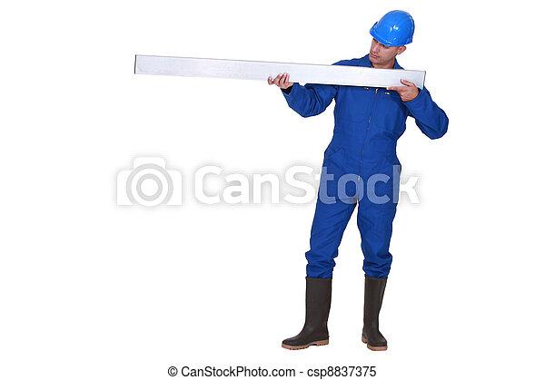Tradesman holding a girder - csp8837375