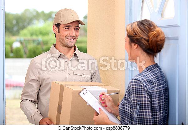 Courier delivering a parcel - csp8838779
