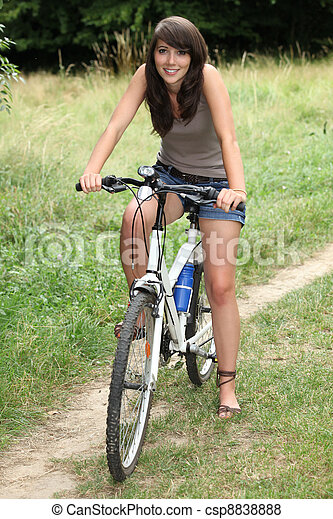 young woman doing mountain bike in the country - csp8838888