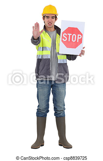 craftsman holding a stop sign - csp8839725