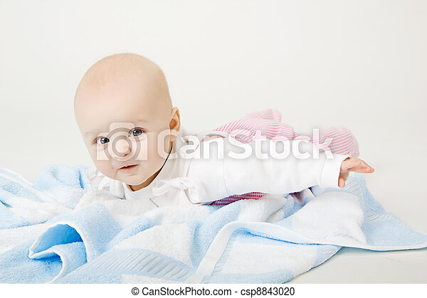 lovely blue-eyed baby with blue towel on the floor - csp8843020