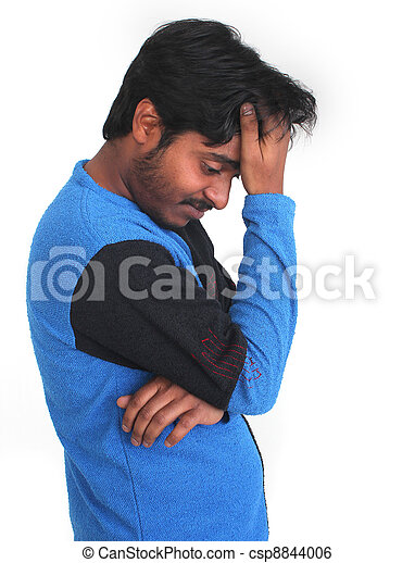 Young male person in gloomy mood with head on hands - csp8844006