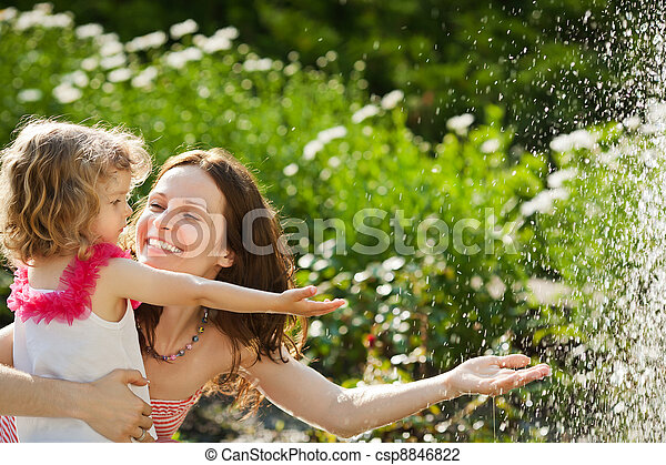 Woman with child playing in spring park - csp8846822