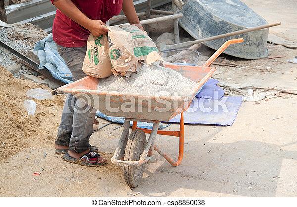 Builder laborer man mixing cement  - csp8850038