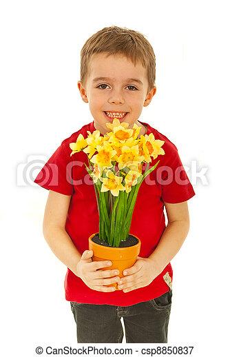 Happy boy offering flowers - csp8850837