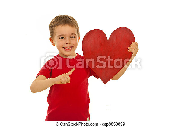 Happy kid pointing to heart shape - csp8850839