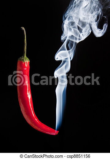 Smoking red hot chilli pepper with burning tip and smoke - csp8851156