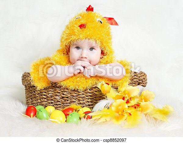 Baby in Easter basket with eggs in chicken costume - csp8852097
