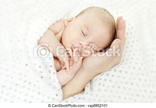 Newborn baby sleeping on parent hand - csp8852101