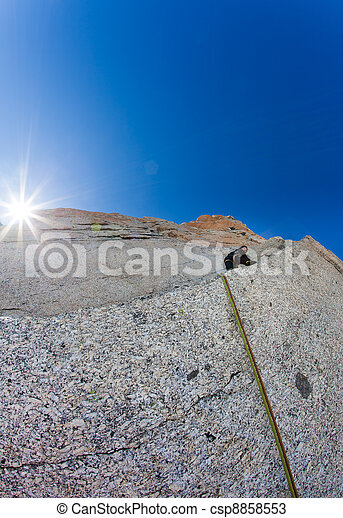 Climber on a steep rock wall - csp8858553