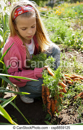 Girl in vegetable garden - csp8859125