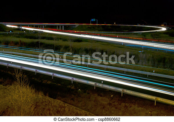 Blurred lights of cars on the highway. Night picture on motorway transportation. - csp8860662