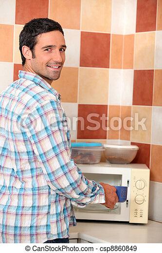Man using microwave - csp8860849